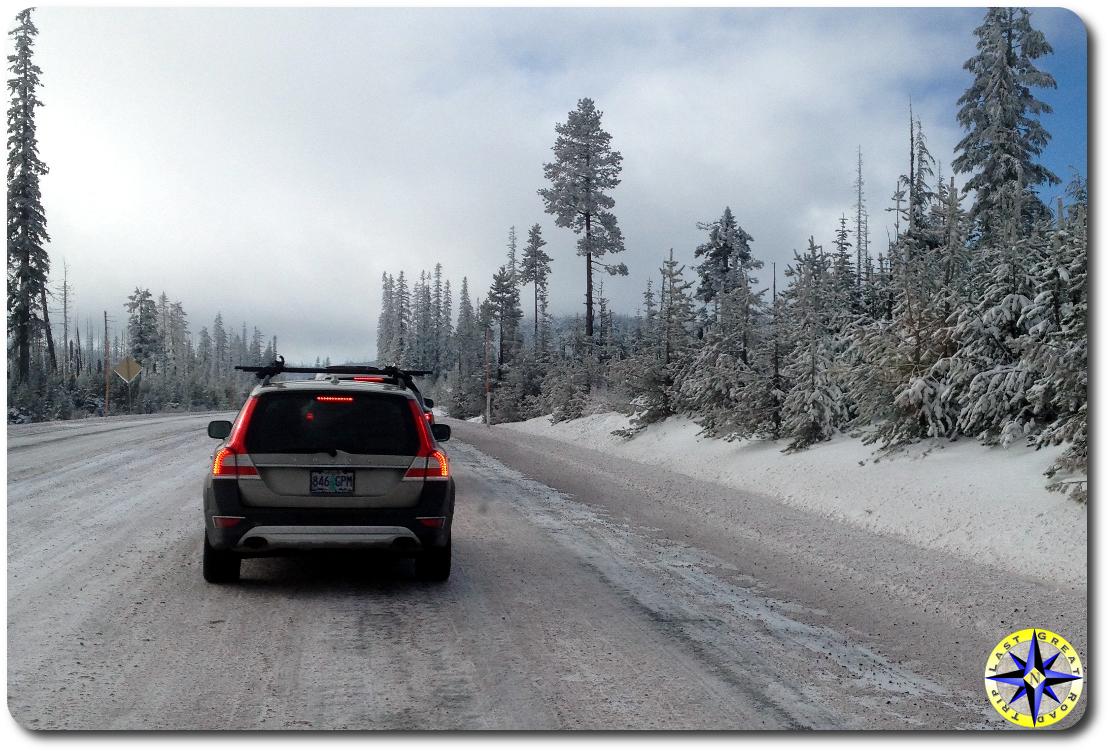 volvo driving snowy pass