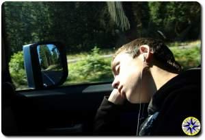 boy asleep in the passenger seat