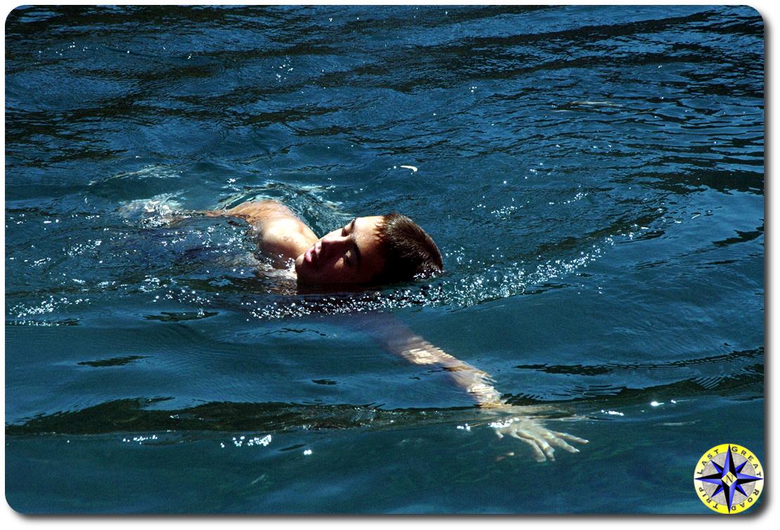 boy swimming lake