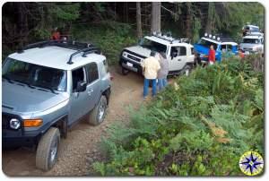 Toyota fj cruisers waiting on 4x4 trail