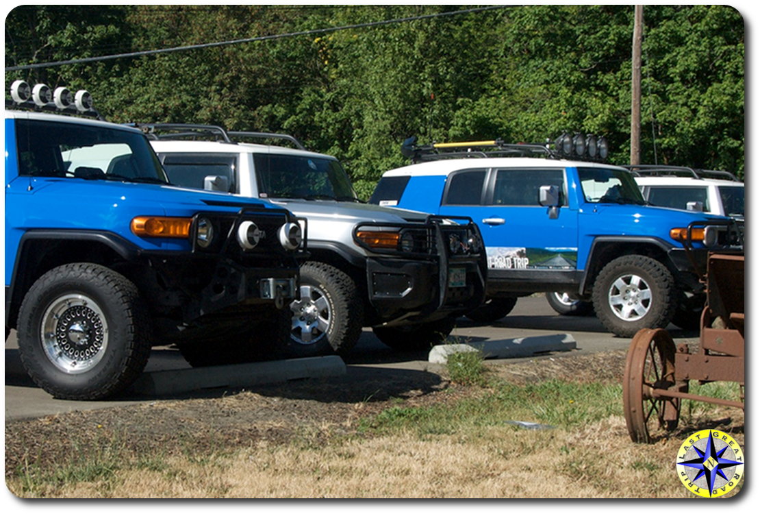 four fj cruisers parked