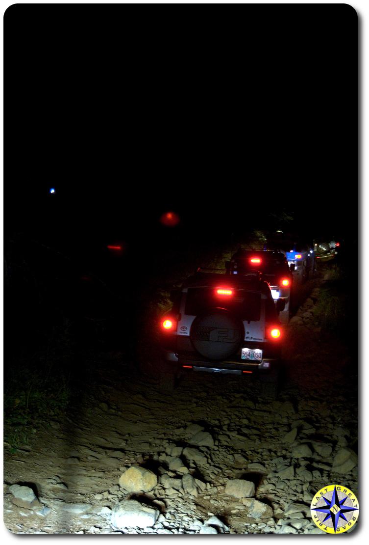 toyota fj cruisers tail lights on 4x4 trail at night