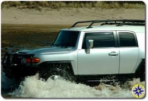 silver fj cruiser fording water