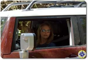 blonde woman driving FJ Cruiser