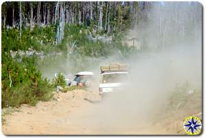 land rover driving dusty 4x4 trail