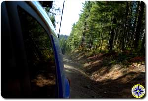 fj cruiser looking Back wooded trail