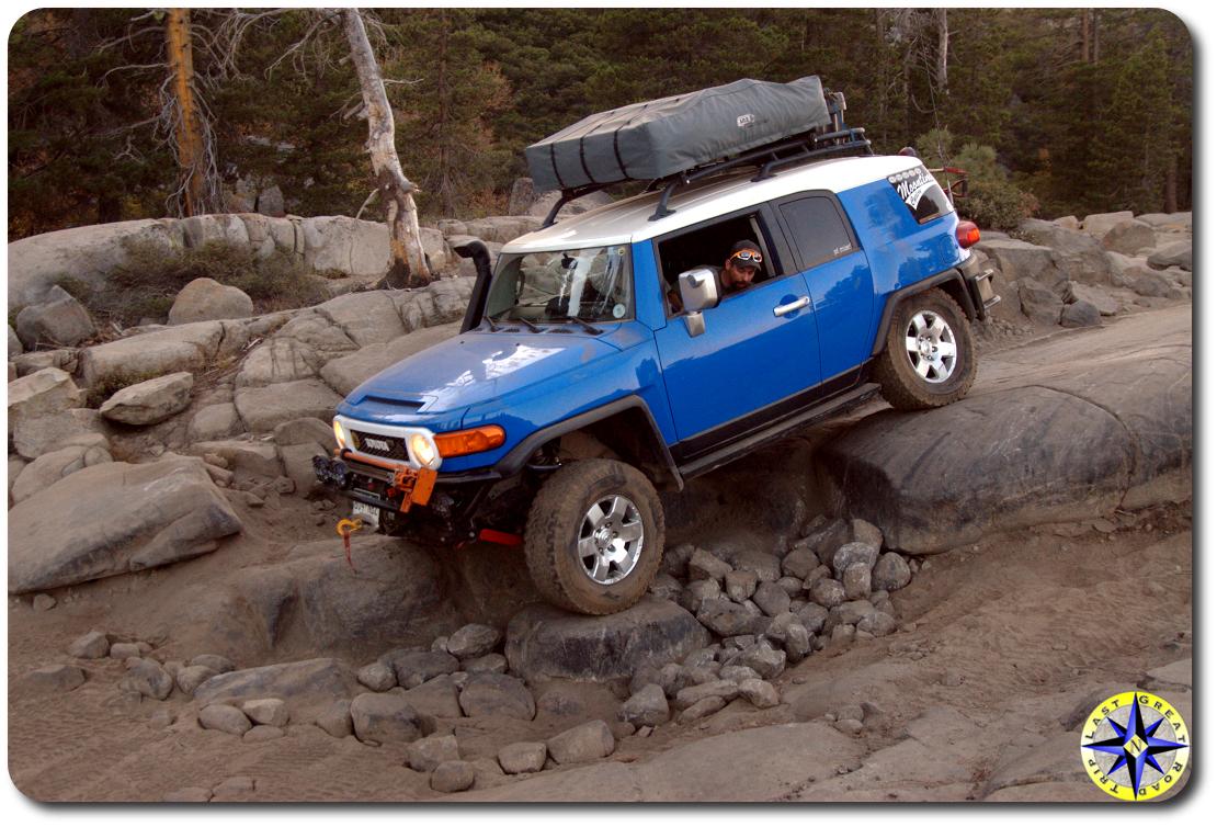 toyota voodoo blue fj cruiser roof top tent rubicon trail boulders