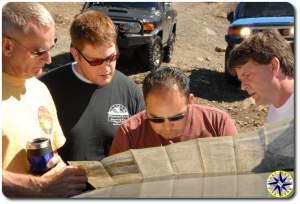 men examining the map