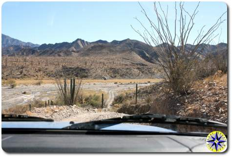 dirt road through dry river bed baja mexico