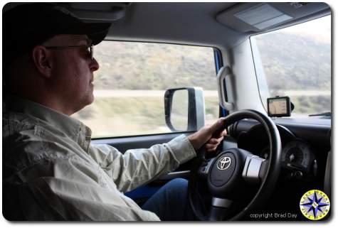 man driving fj cruiser on highway