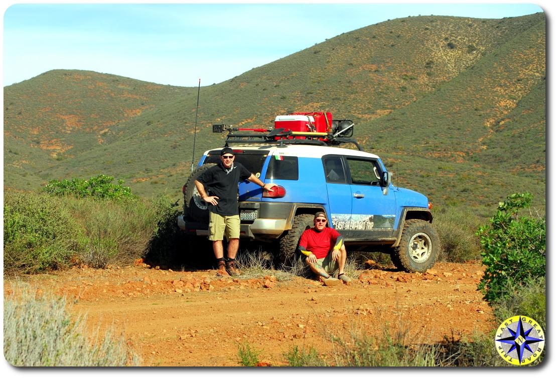 men fj cruiser side of Baja mexico dirt road
