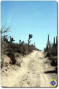 baja mexico sandy dirt road hill