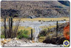 baja mexico road through dry river bed
