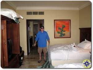 man standing in cabo hotel room