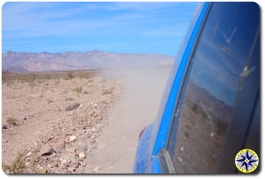 dusty road behind fj cruiser