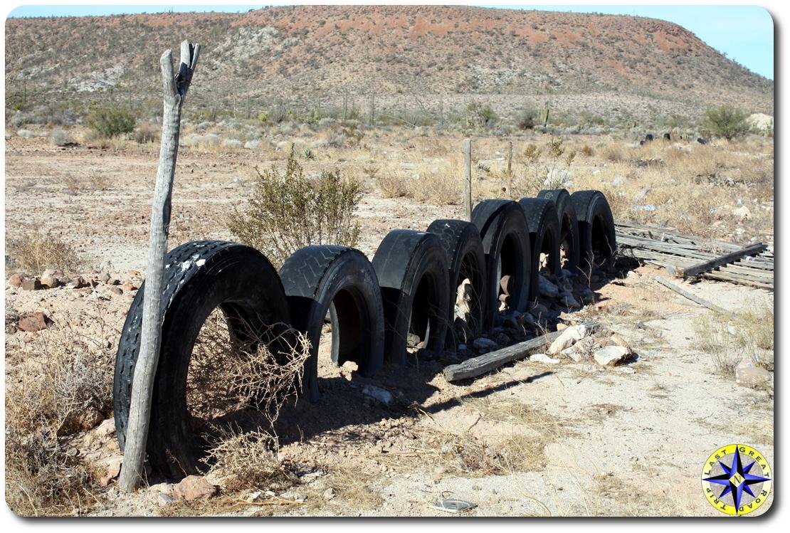 half burried tire fench baja mexico