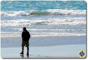 man walking pacific ocean beach baja mexico