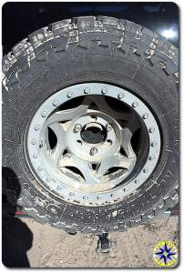 sand covered spare tire toyo open country mt