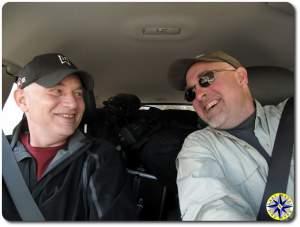 two laughing men driving fj cruiser