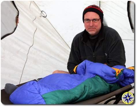 man in sleeping bag camping