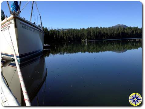 boat and reflection on suttle lake dock