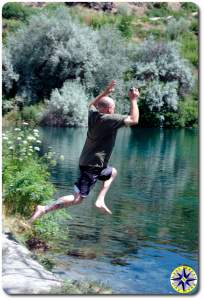 jumping into swimming hole