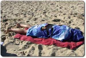 asleep on the beach