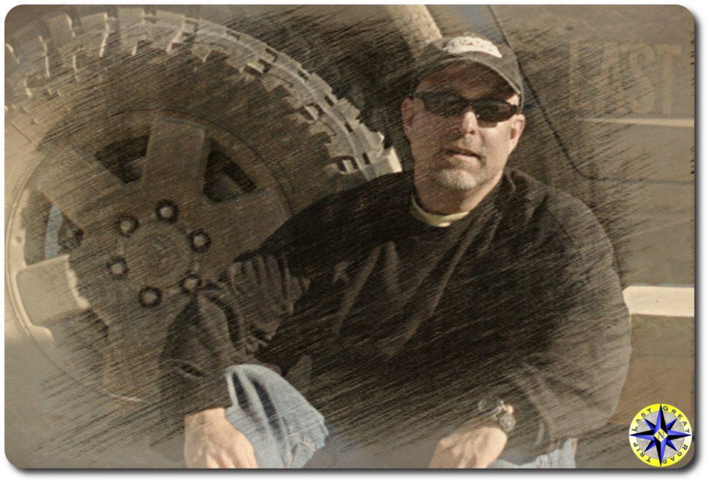 paul - sketch man sitting next to truck tire