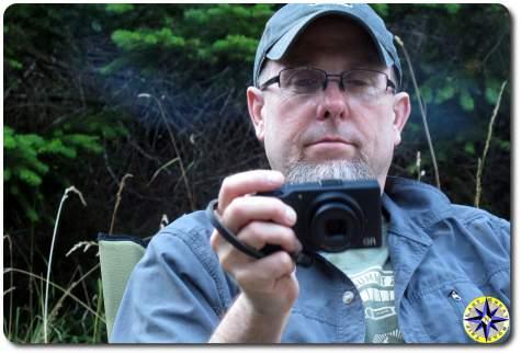 man checking camera