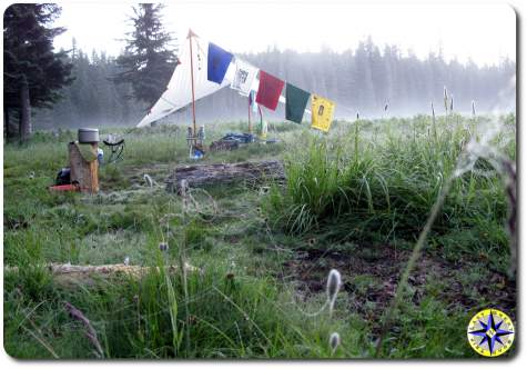 sunrise camp prayer flags minimalist primitive camping