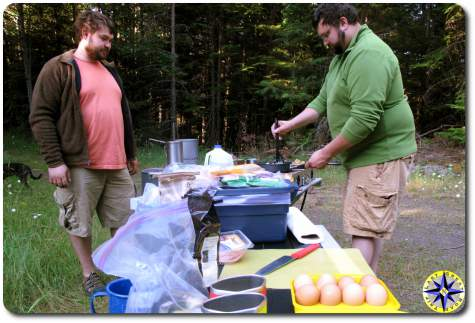 men cooking camping breakfast