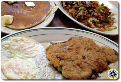 chiken fried steak and hash browns and pancake breakfast