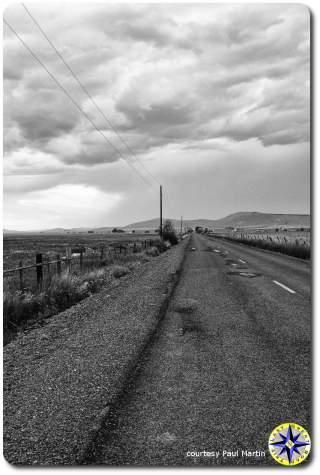 storm clouds over endless highway utah